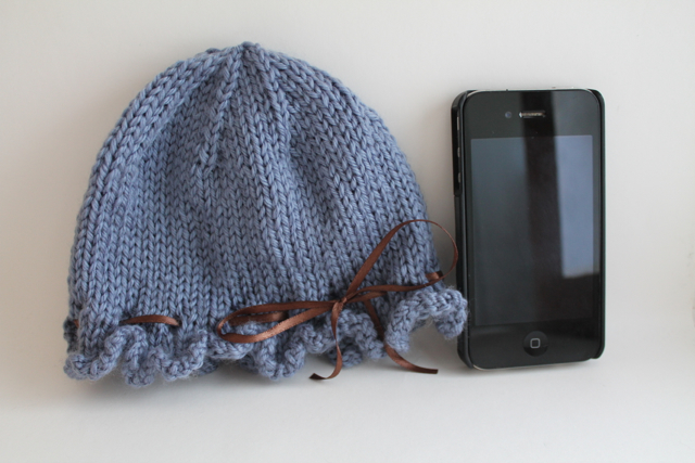 Ruffled hat with iPhone