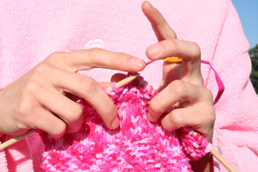 Pink_knitting_in_front_of_pink_sweatshirt